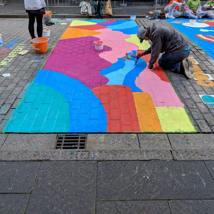 Reform Street Re-Formation event, with artists painting on the road