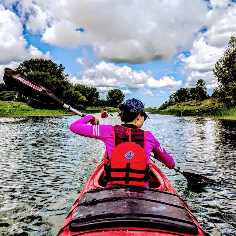 A girl is paddling in a kayak