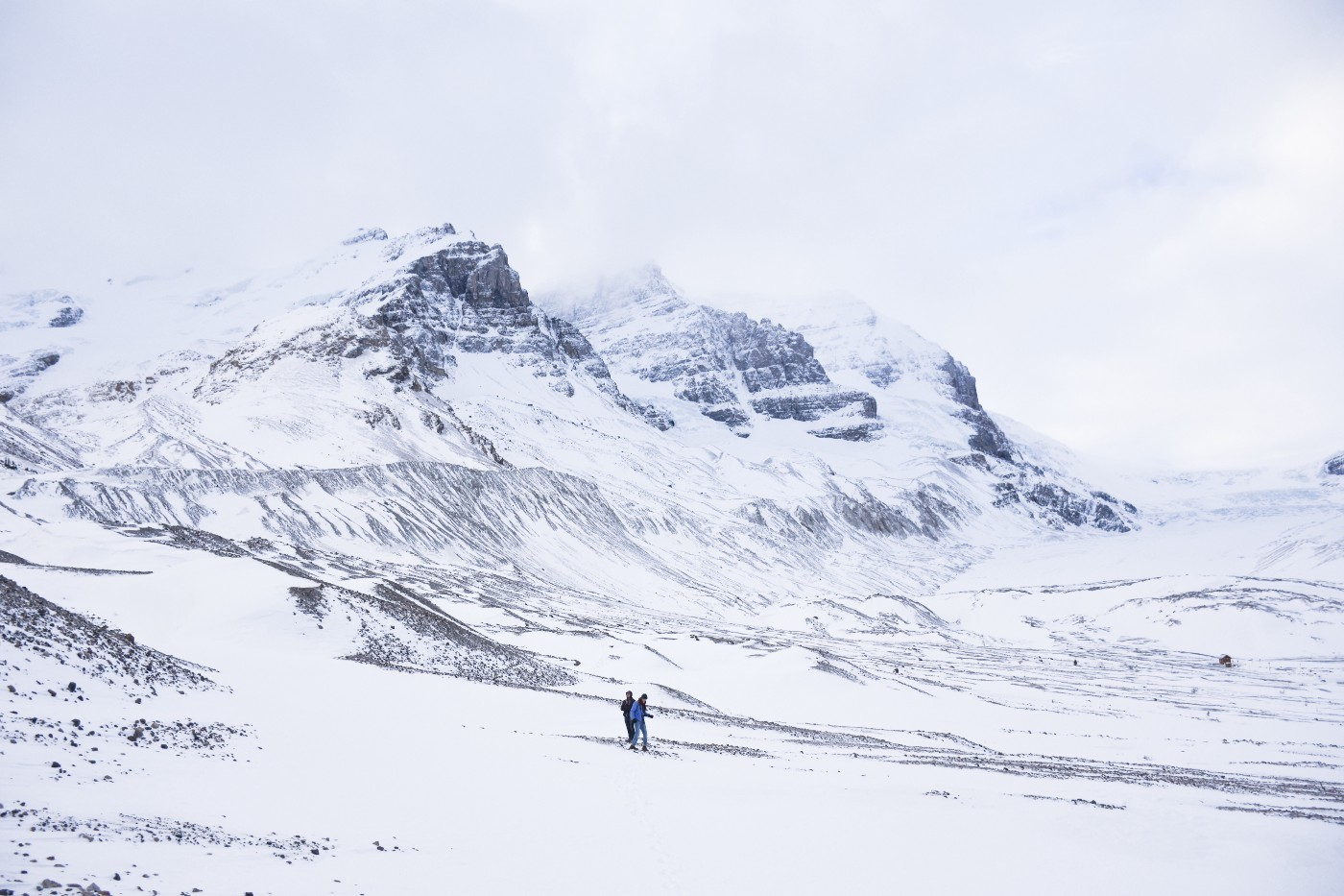 Athabascan glacier in the Columbian Icefields two people walking on it