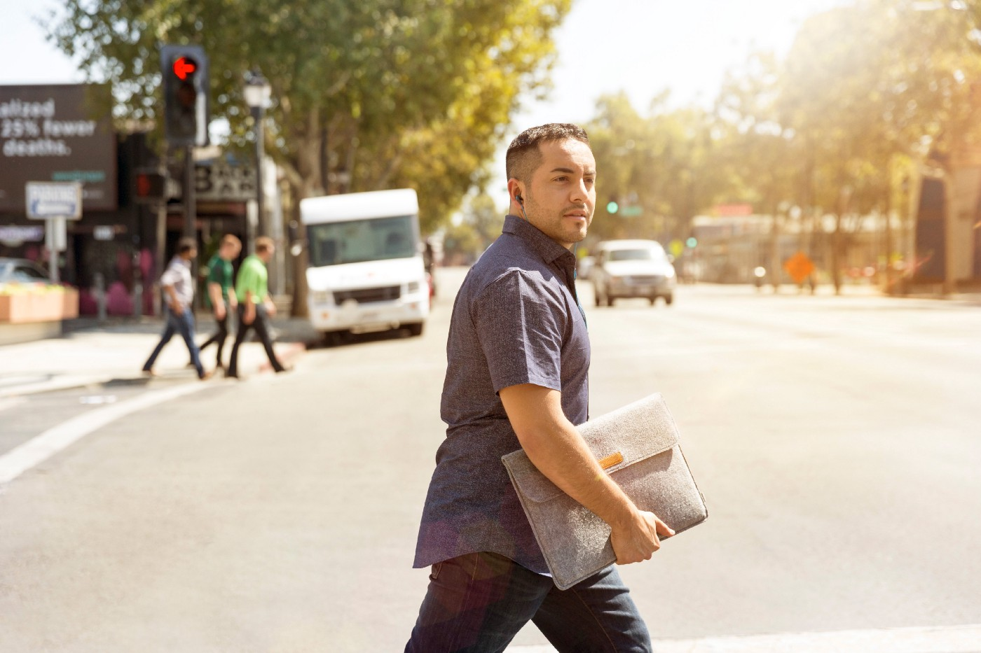 A Guy crossing the road in lost in thoughts, probably looking for a job