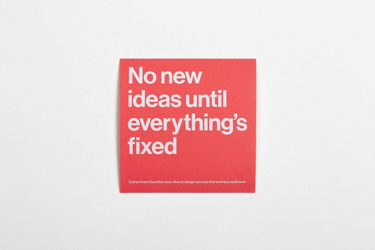 """A sticky note with the words on it """"no new ideas until everything's fixed"""""""