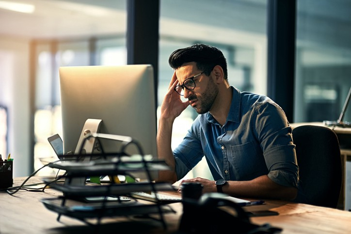 An employee stressed out and demotivated by his work