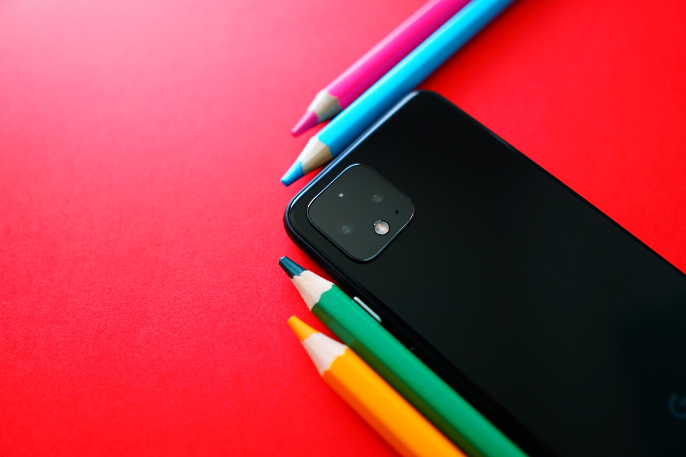 Crayons surrounding a phone