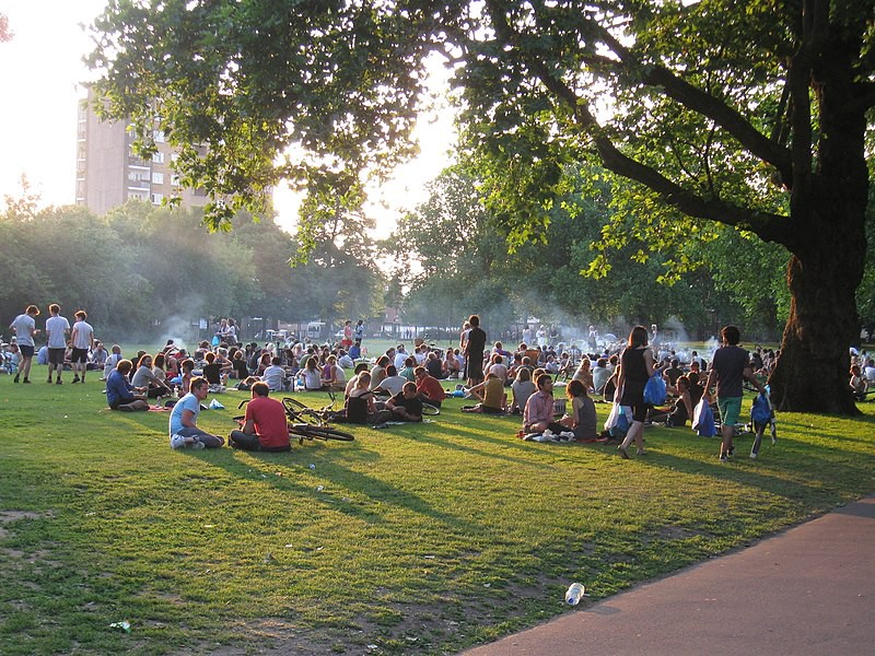 A photograph of London Fields with many people in it.