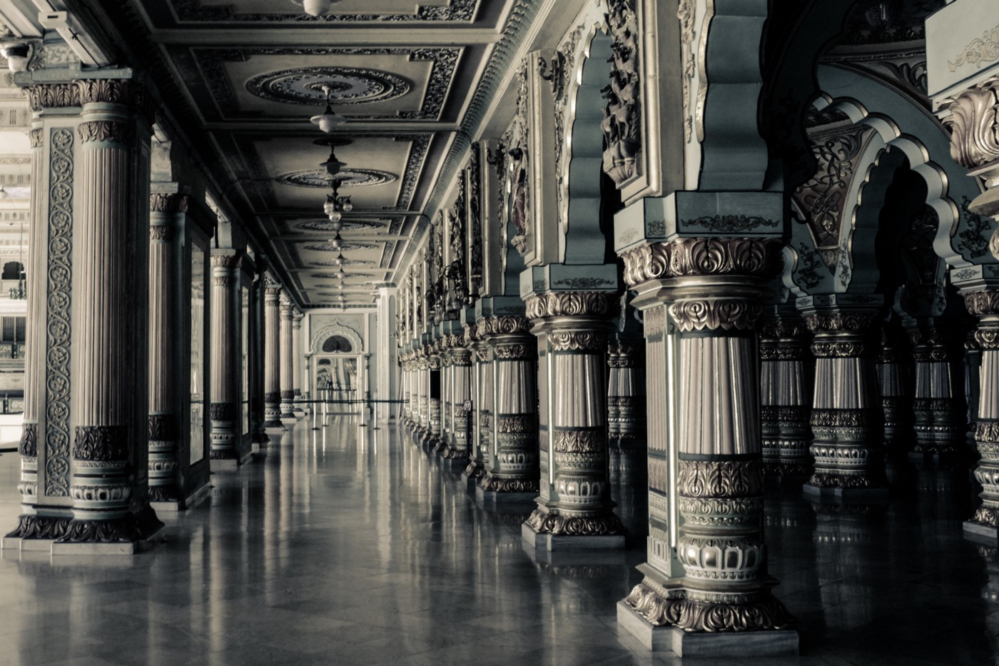 A hall filled with Greek columns.