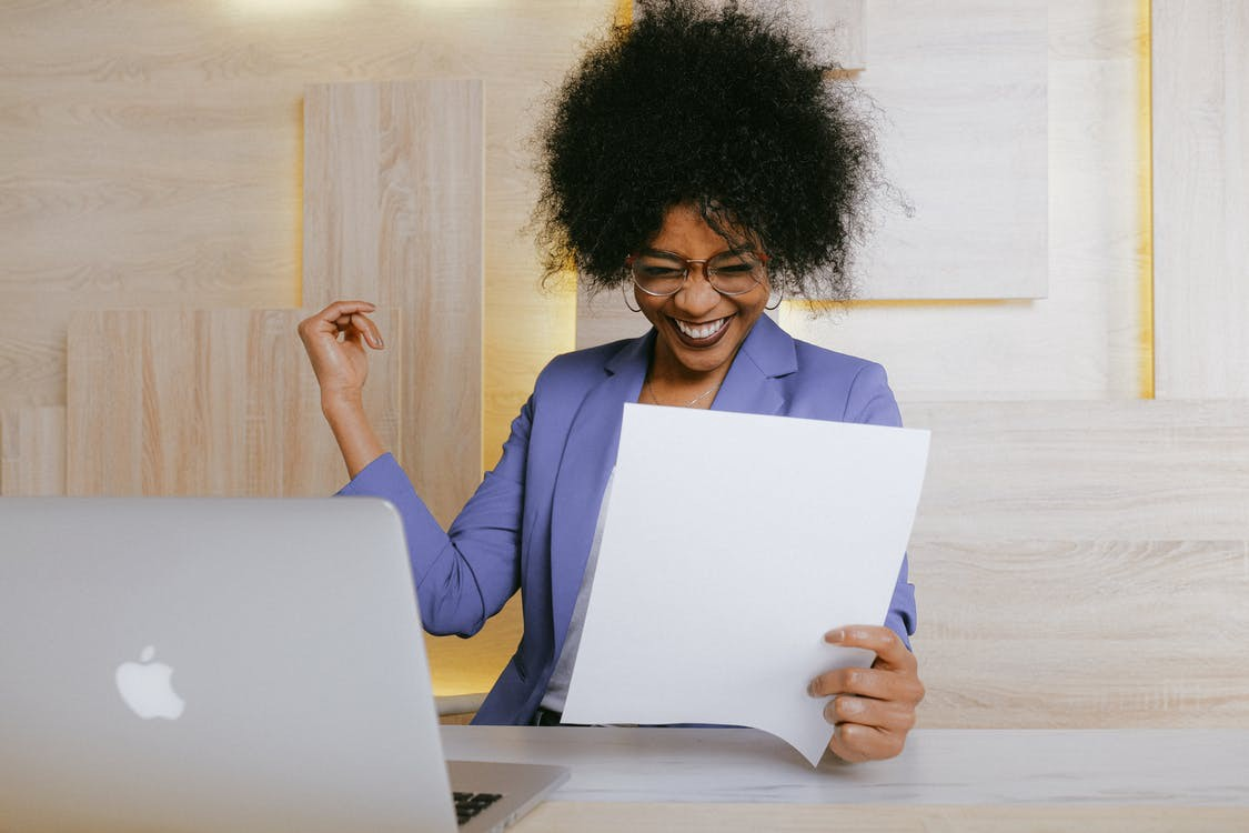 Woman at work feeling successful and looking healthy