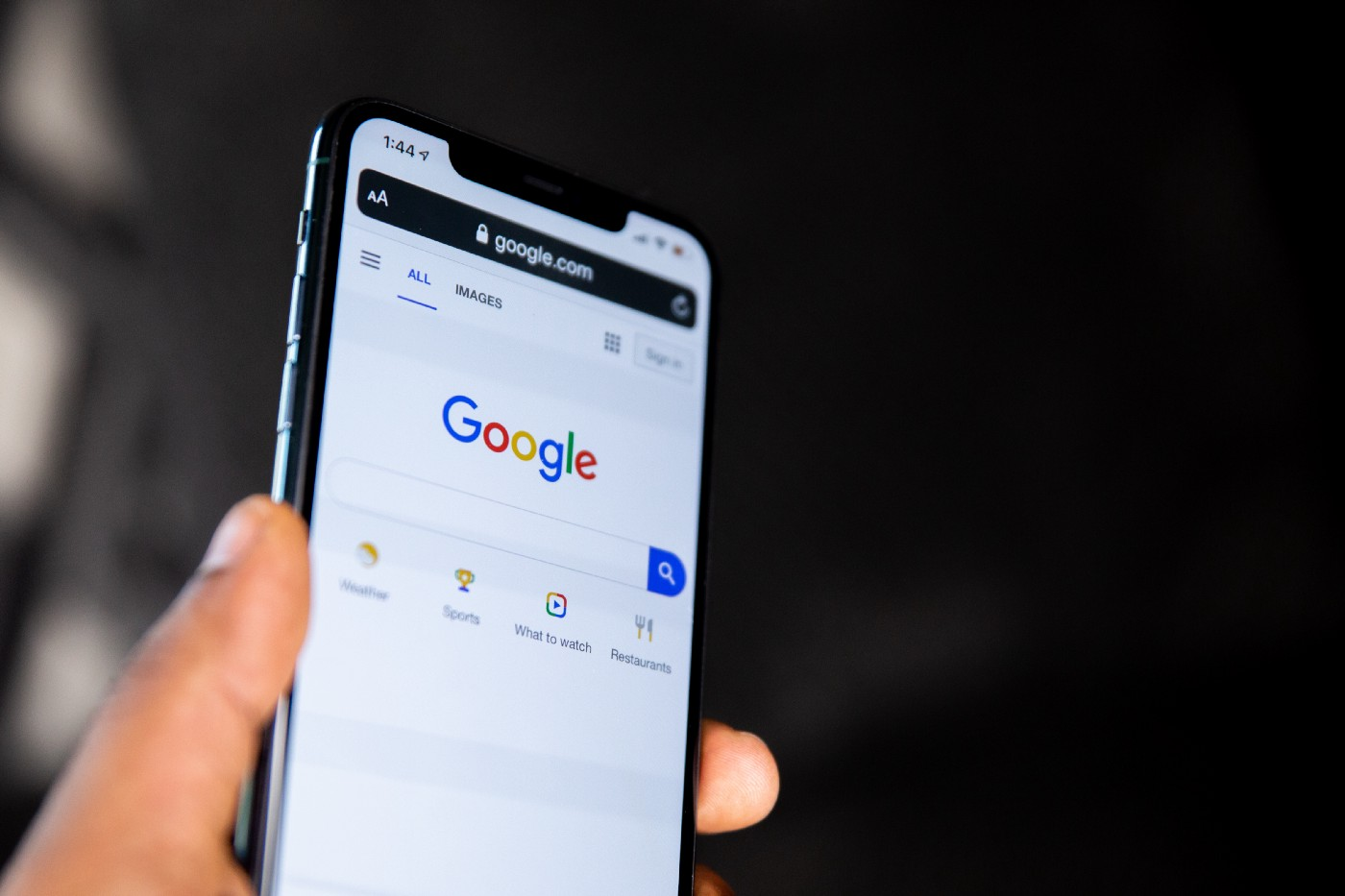 mobile phone showing Google search screen