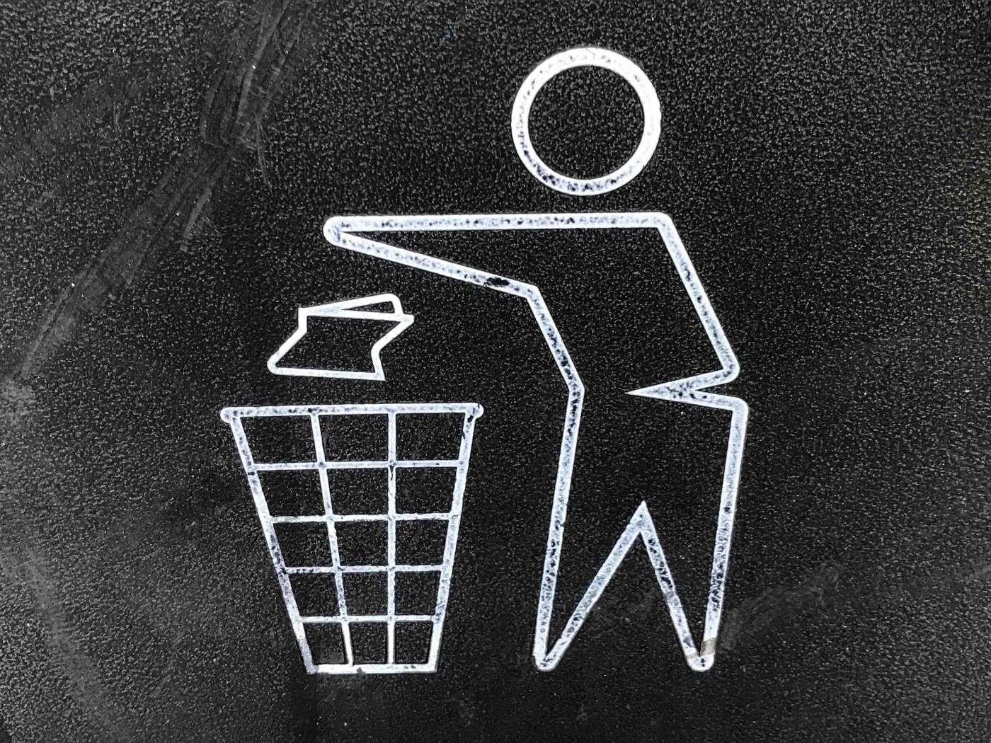 A stick figure throws a piece of litter in a trash bin. Jim's Shorts on Substack.