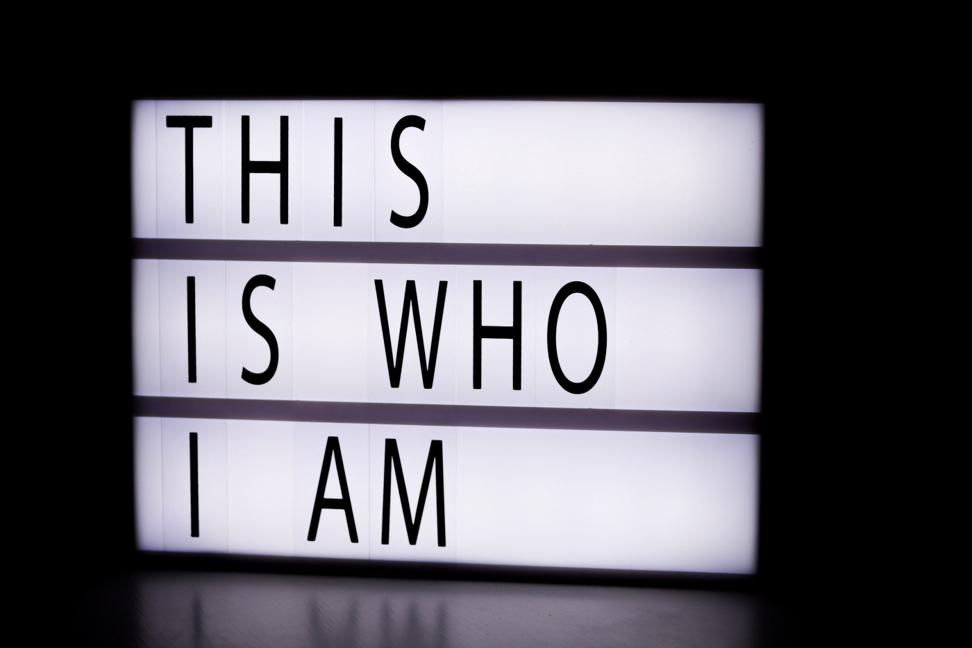 An illuminated sign with the words: 'This is who I am' written