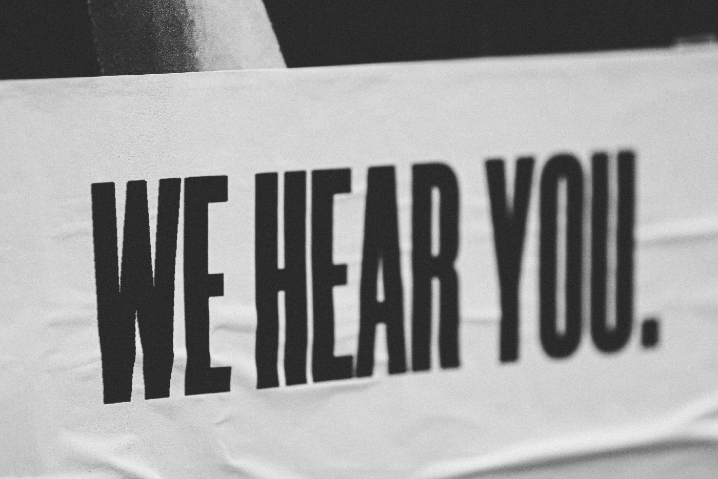 """A sign that reads: """"We hear you."""""""