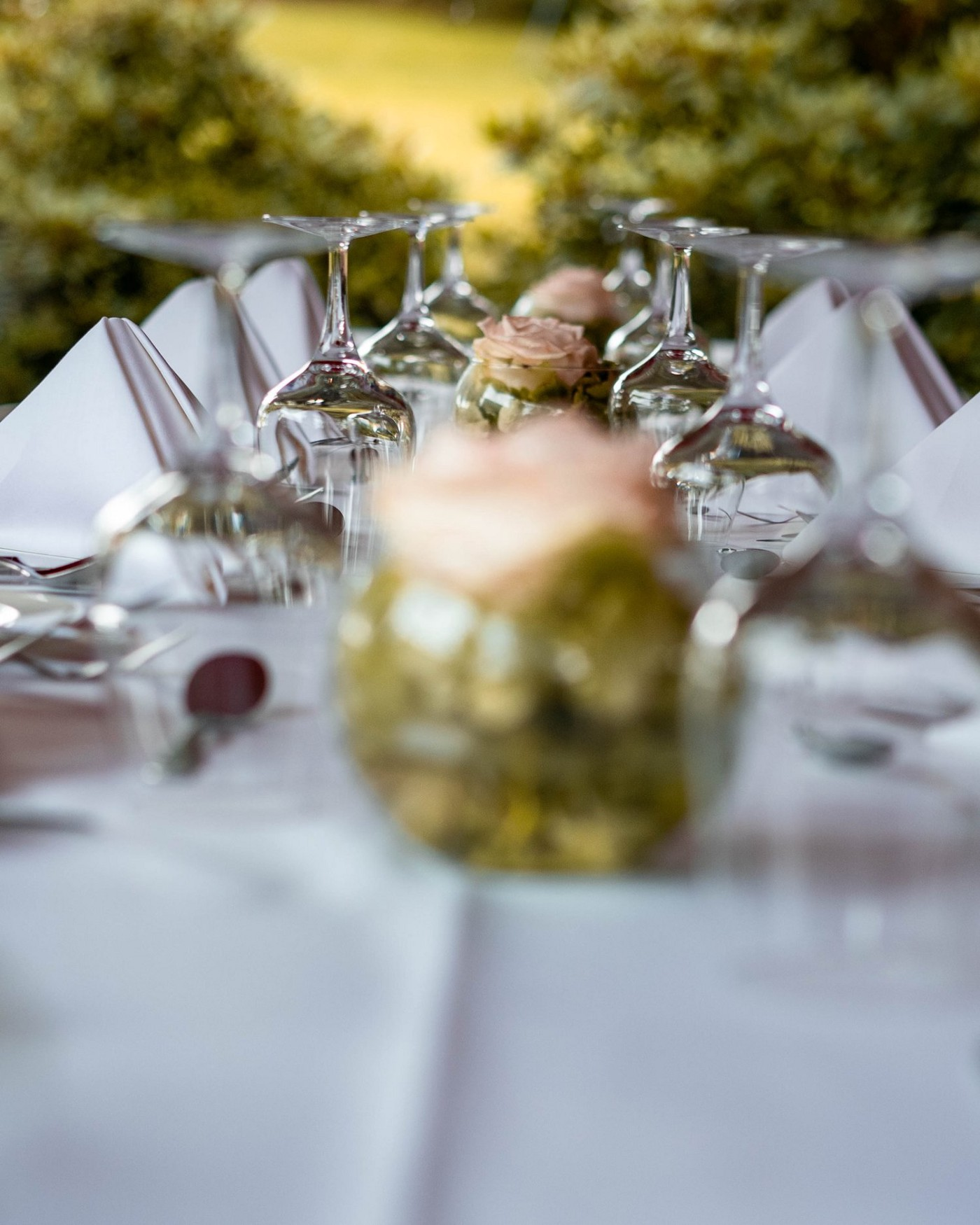 Wine Glasses on a table with center pieces