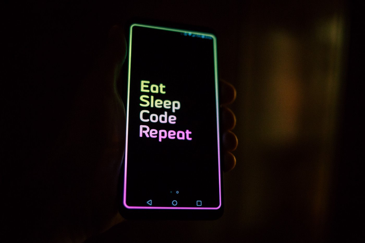 "Image: Phone that says, ""Eat, sleep, code, repeat."""