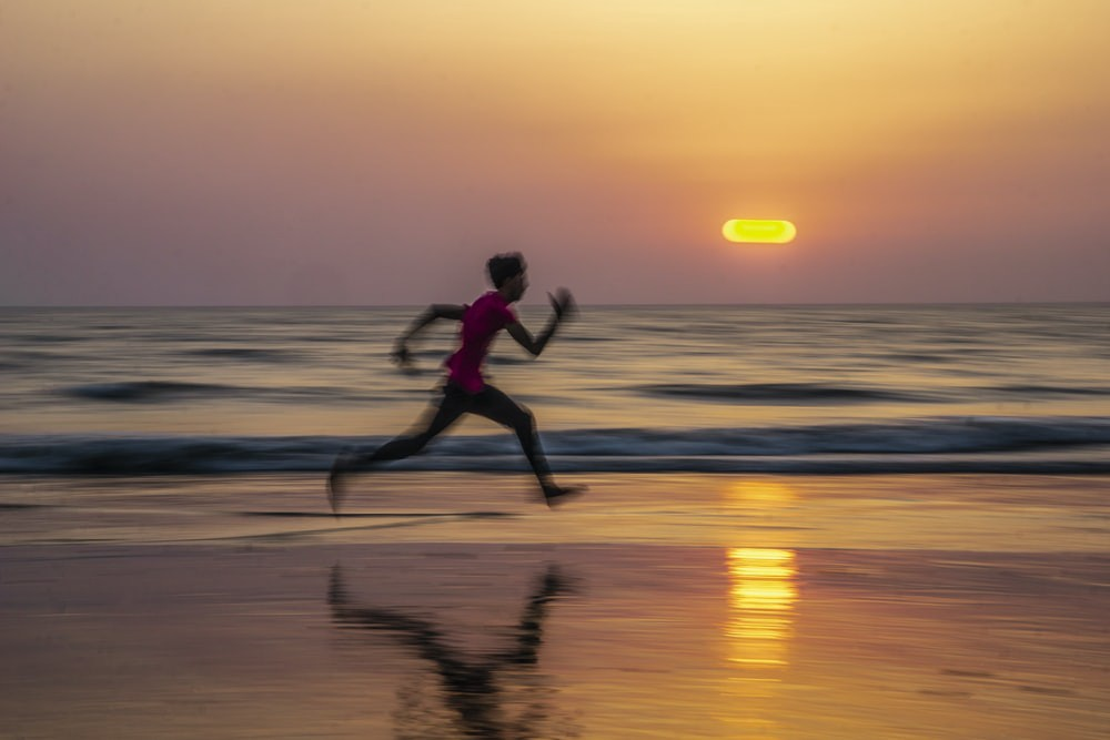 Man Running on Beach with Sunset in the background