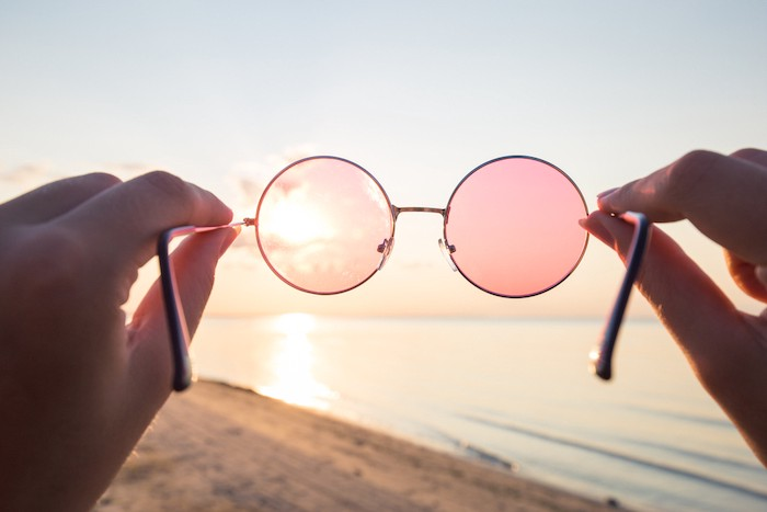 rose colored glasses looking at the beach