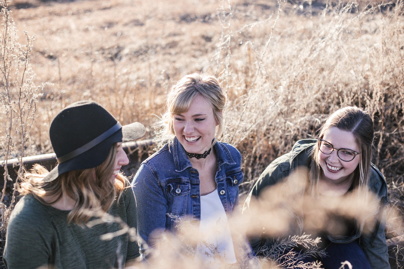 Three young women laughing and talking