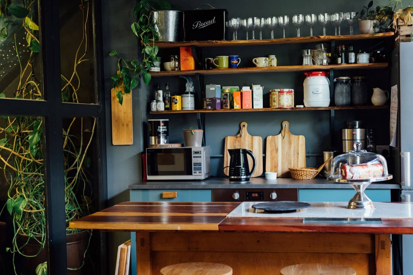 Crowded kitchen counter and shelves