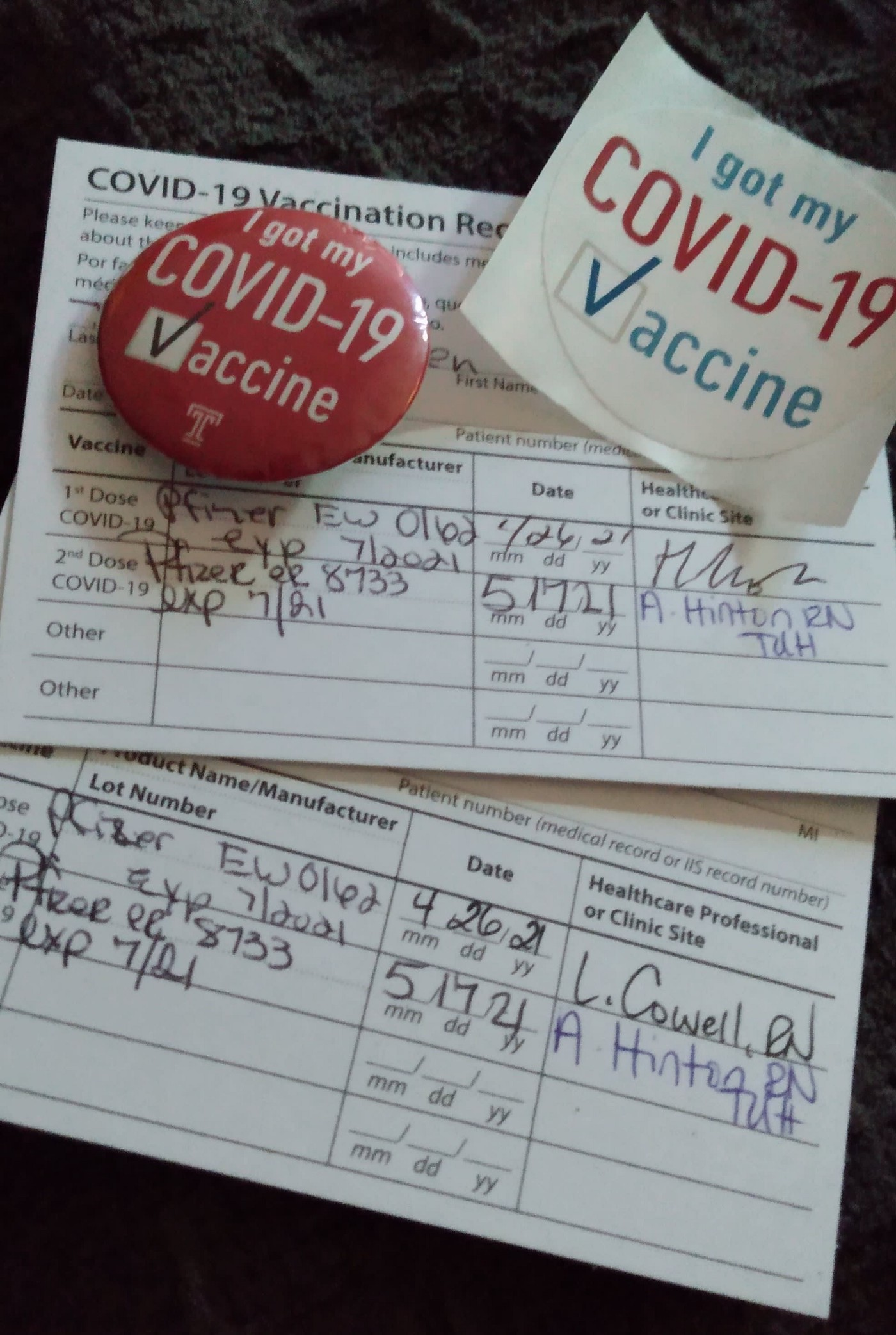 COVID-19 Vaccination cards with a red button and sticker