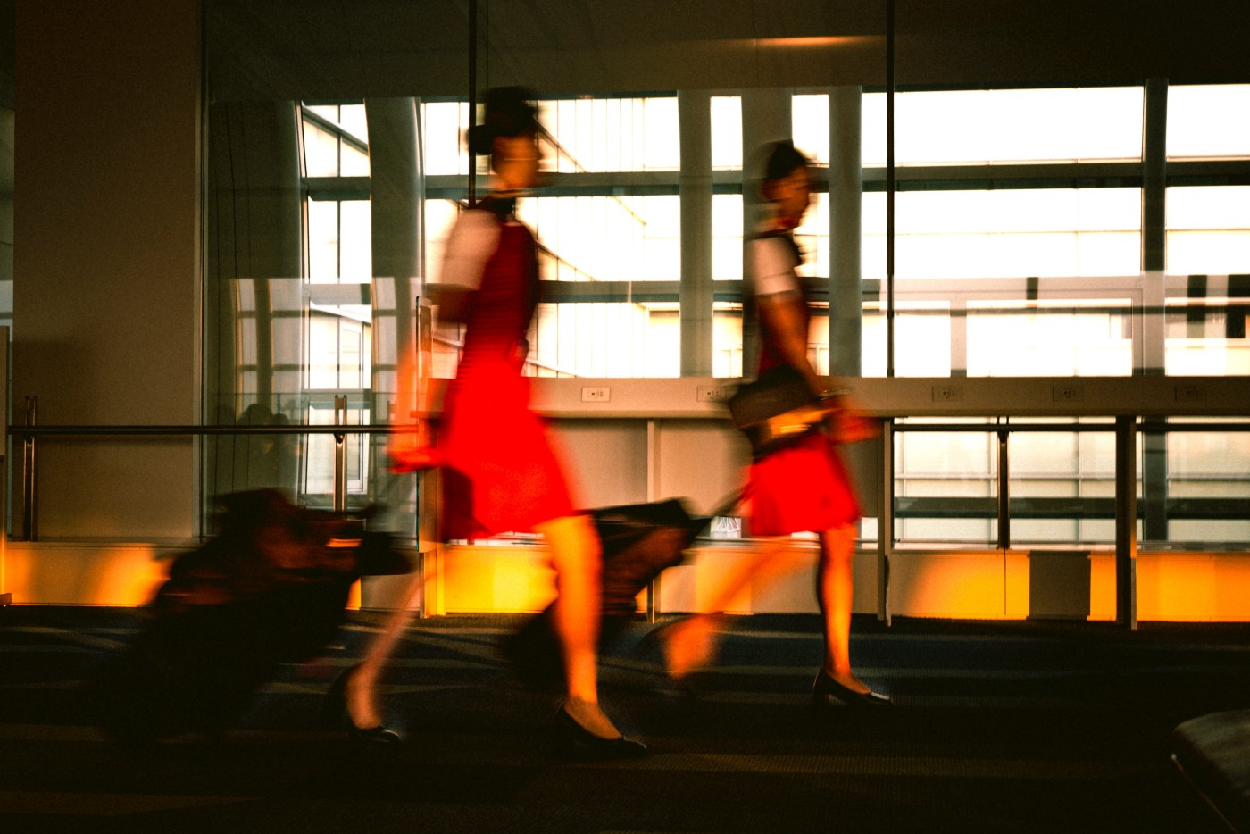 Two flight attendants rush to their next destination