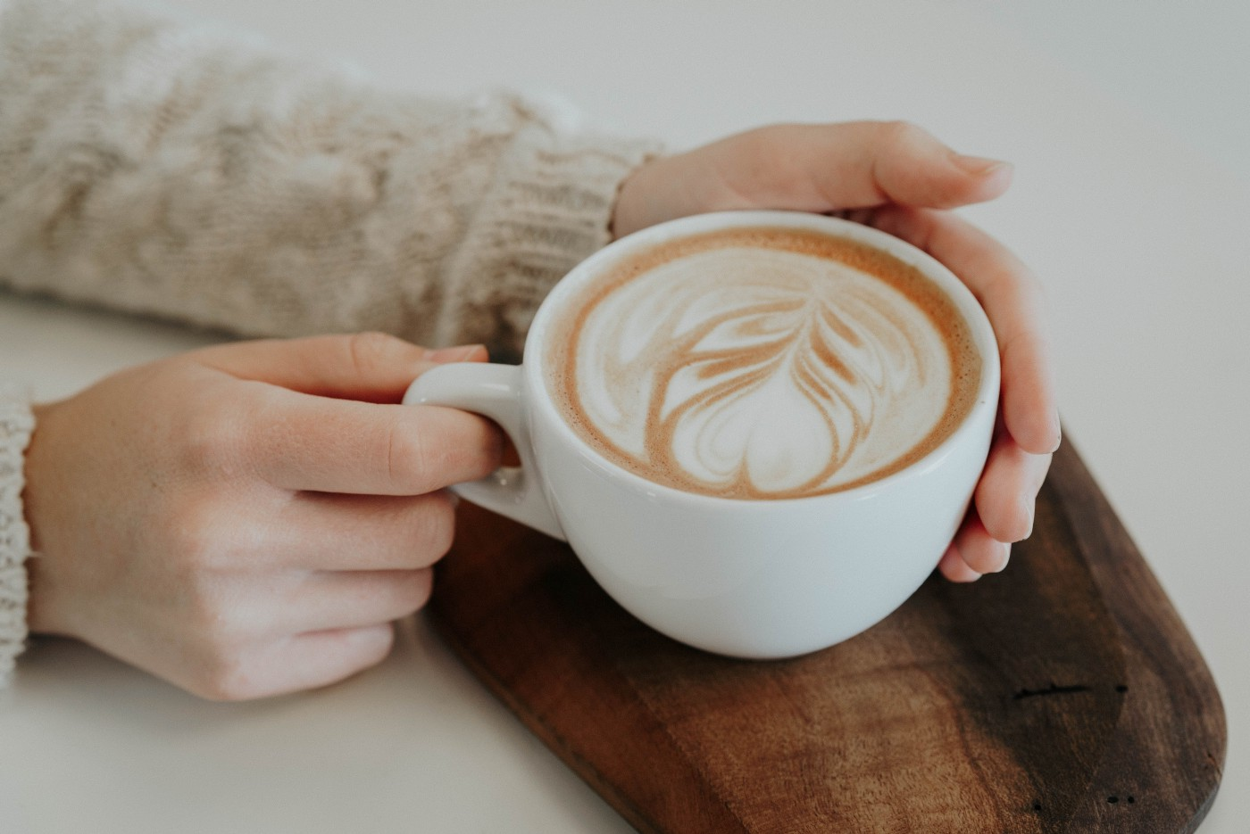 Woman holding a latte cup