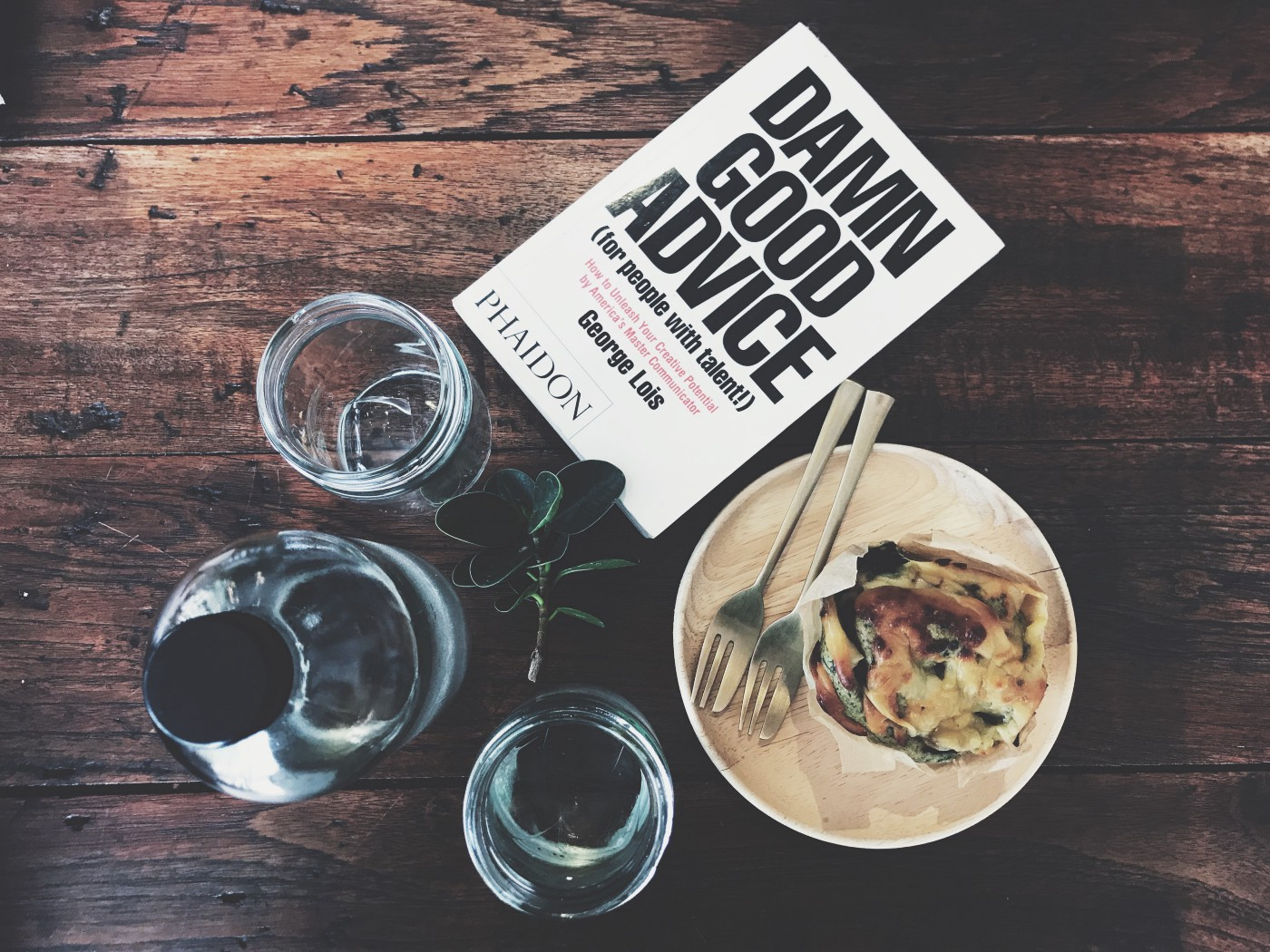 Book and food on table