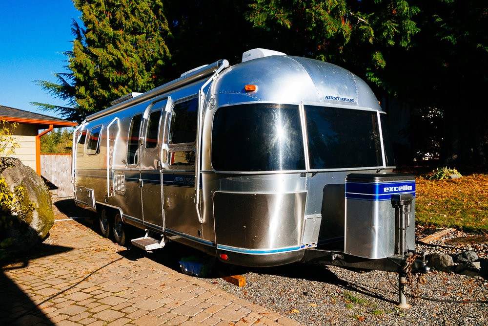This is our second Airstream, a 1992, 29 foot. John's dad and stepmom graciously let us house it in their side yard while we did some renovations.