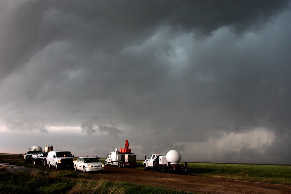 A fleet of VORTEX2 vehicles tracks a supercell thunderstorm near Dumas. Image Credits : NOAA at Unsplash.com