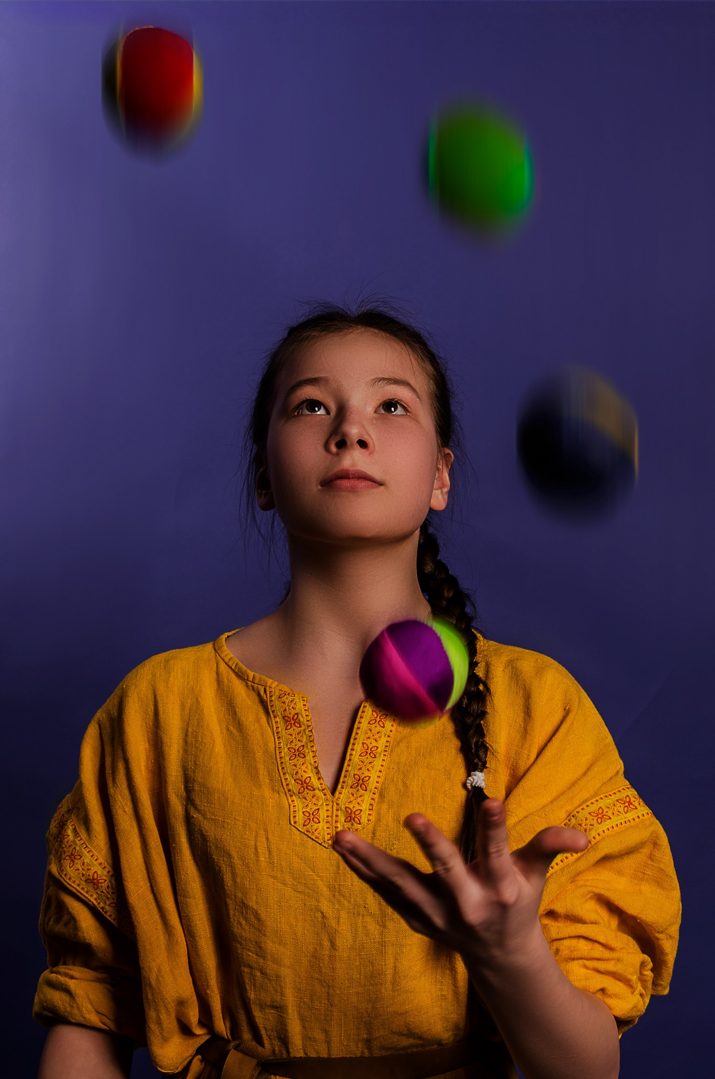 A professional woman is juggling balls, symbolizing her commitments to work, writing, and self-care