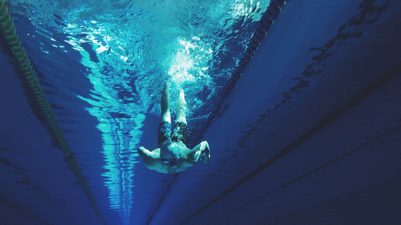 A swimmer underwater at the bottom of a dive