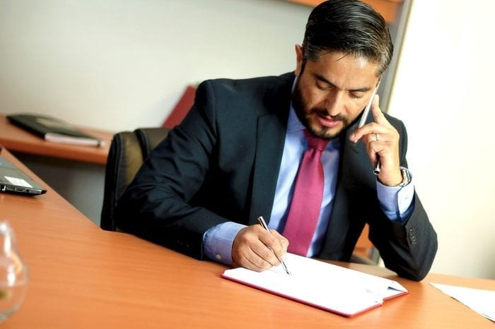 businessman in suit reviewing a legal document