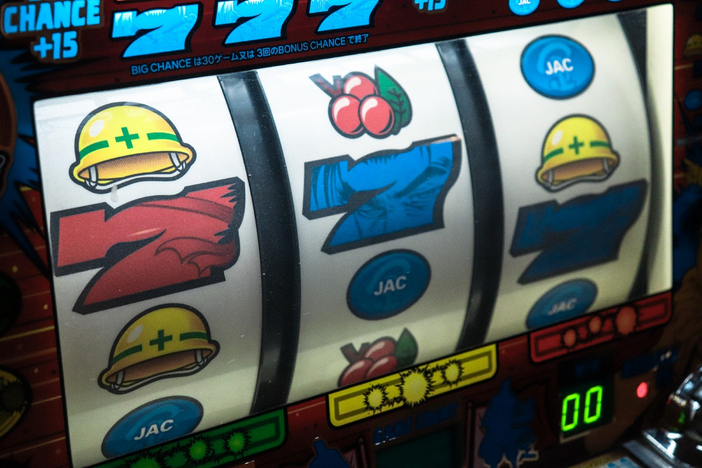 A slots machine showing three sevens.