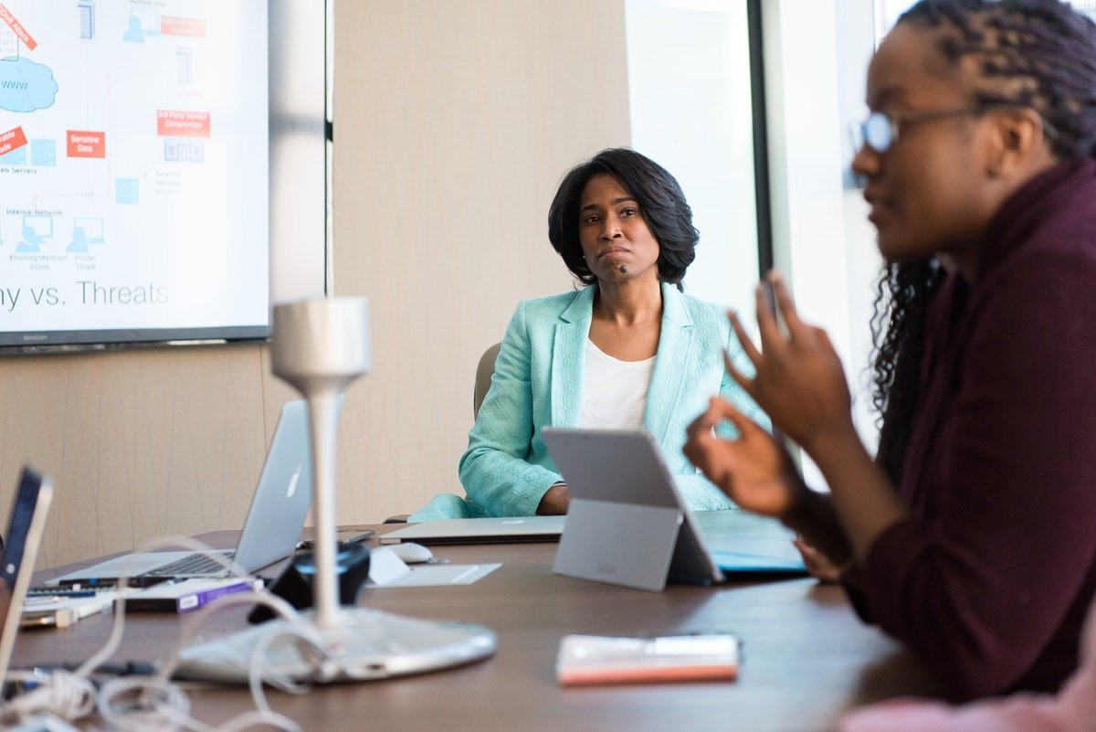 A female boss listening with all attention to her subordinate in a meeting