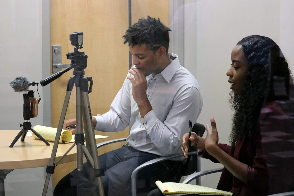 Marketing interns Kyle Chambers and Denielle Smith interview the inventor