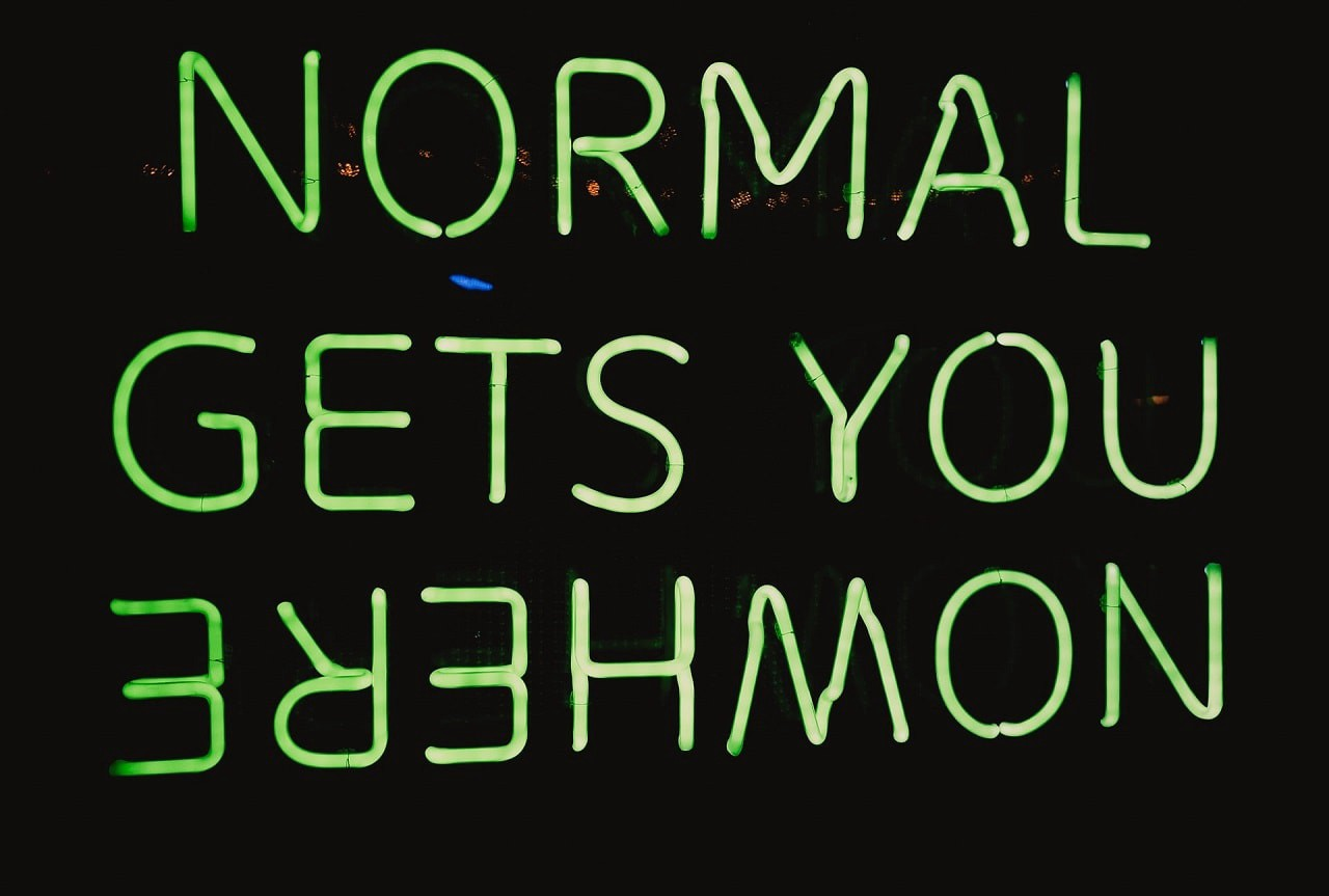 Neon sign that reads, Normal Gets You Nowhere