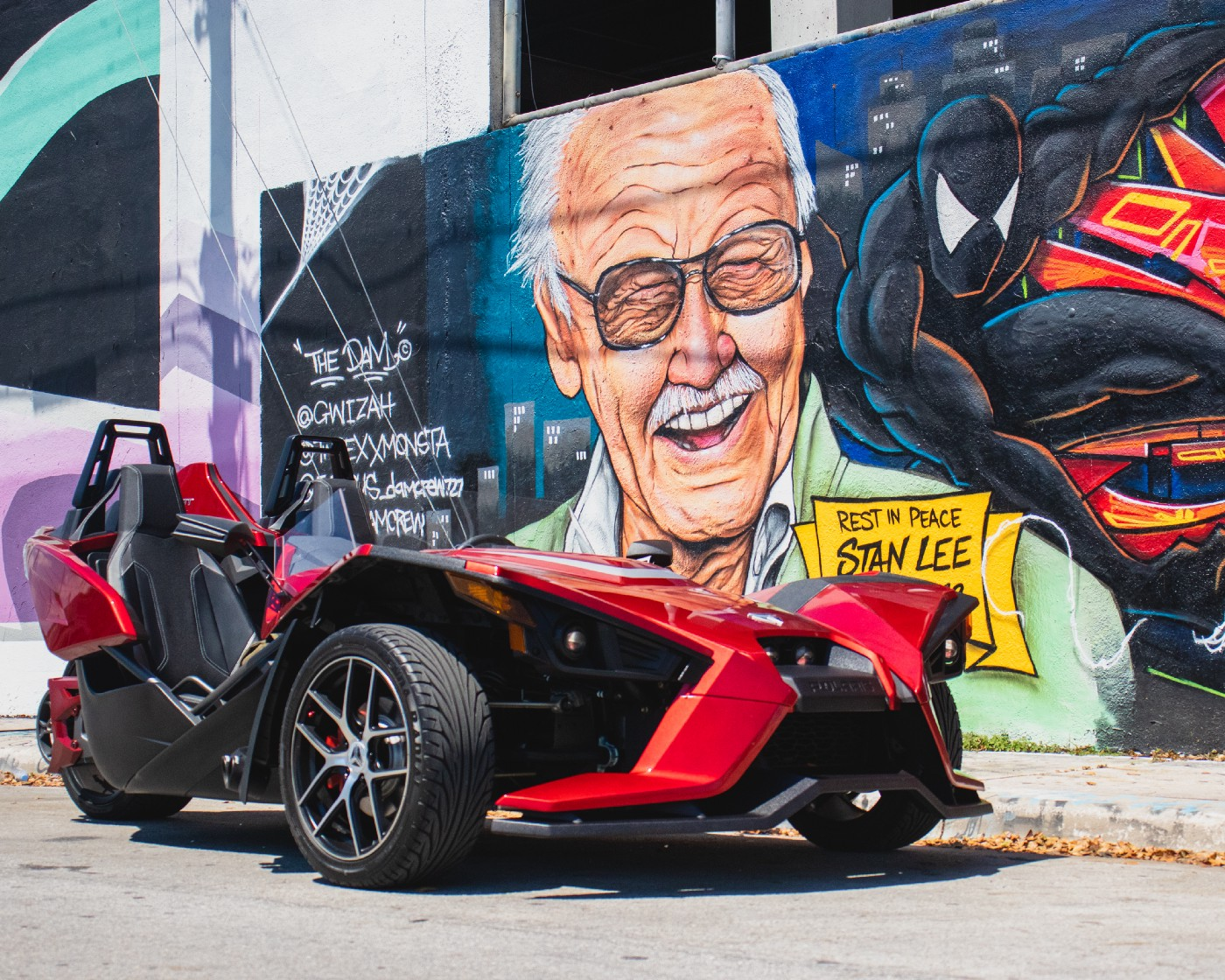 A mural featuring Stan Lee and Spider-Man dressed a black suit. Stan Lee is credited for Modern Marvel success
