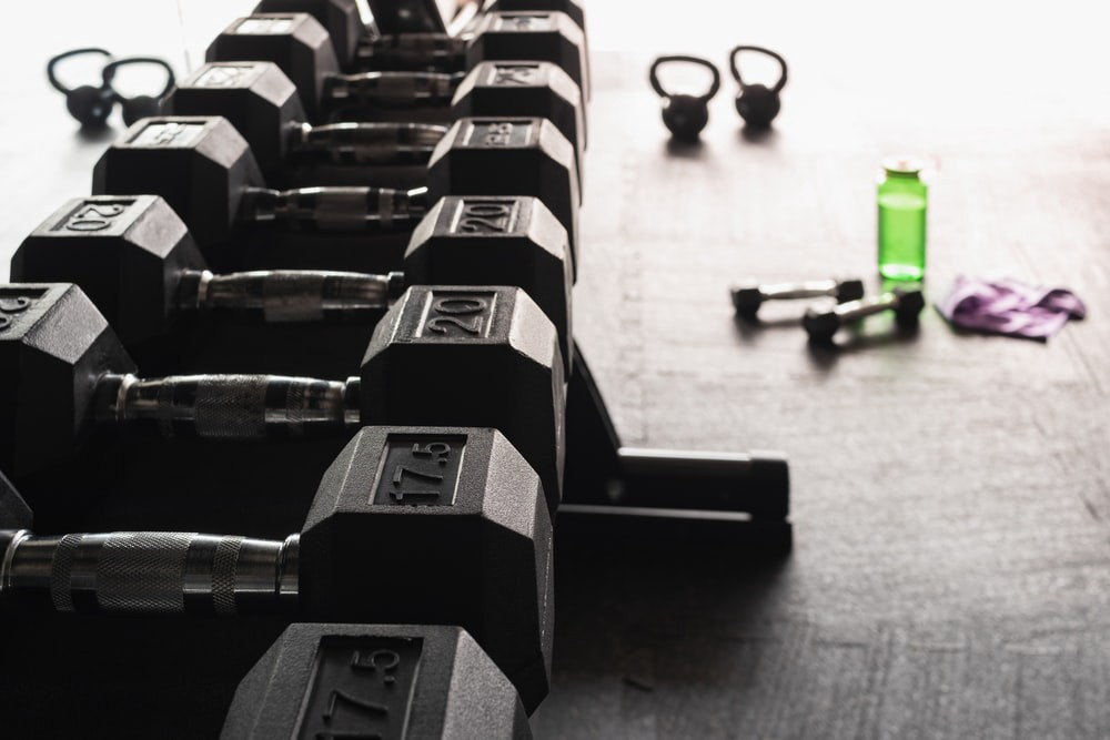 Weights lined up in a gym