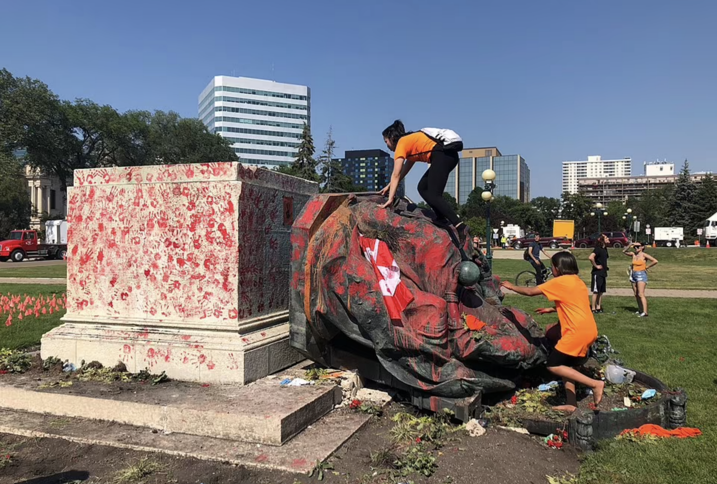 BREAKING: Angry Commonwealth protestors topple and deface statues of Queen Elizabeth and her great-great-grandmother Victoria