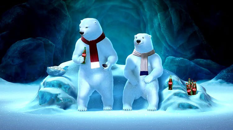 Coca Cola advertisement, with 2 polar bears wearing scarfs, next to bottles of Cola