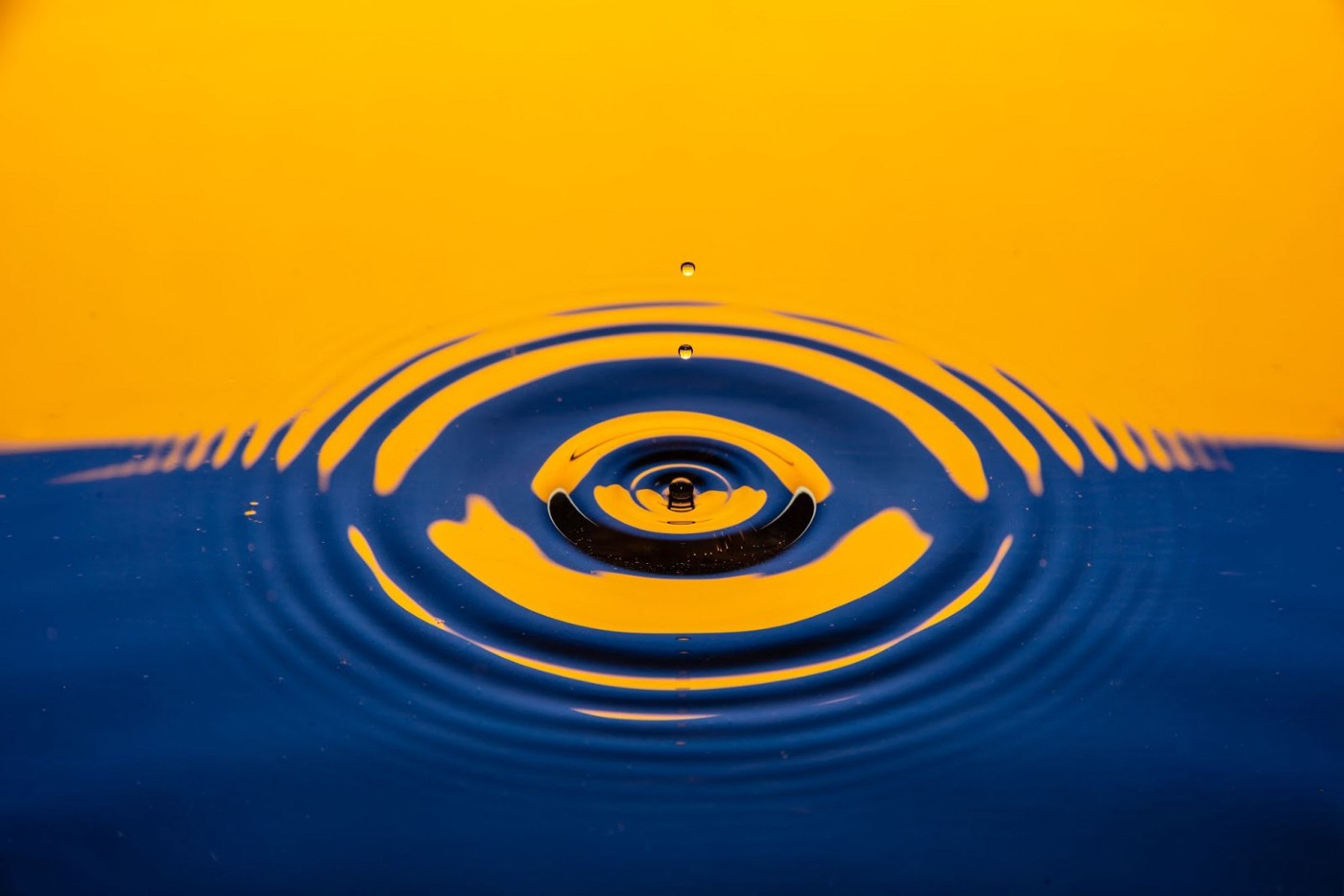 Ripples from a drop of water on a late afternoon