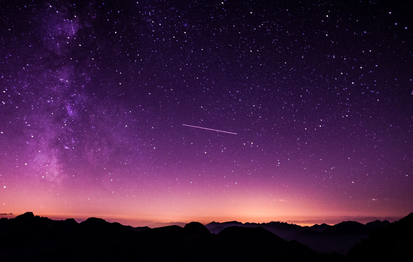 The night sky with stars and a shooting star