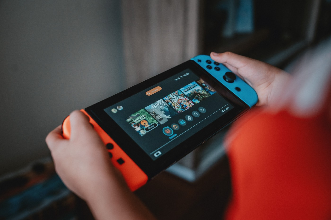 kid playing on nintendo switch console