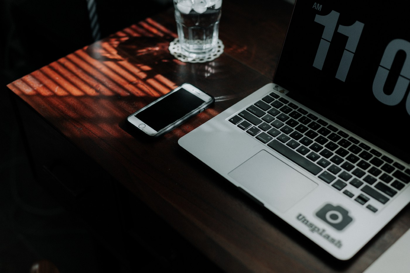 Phone and laptop on table