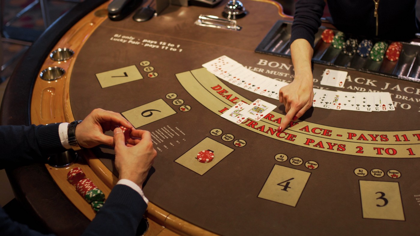 Man playing cards in a casino. Cards on top of casino table