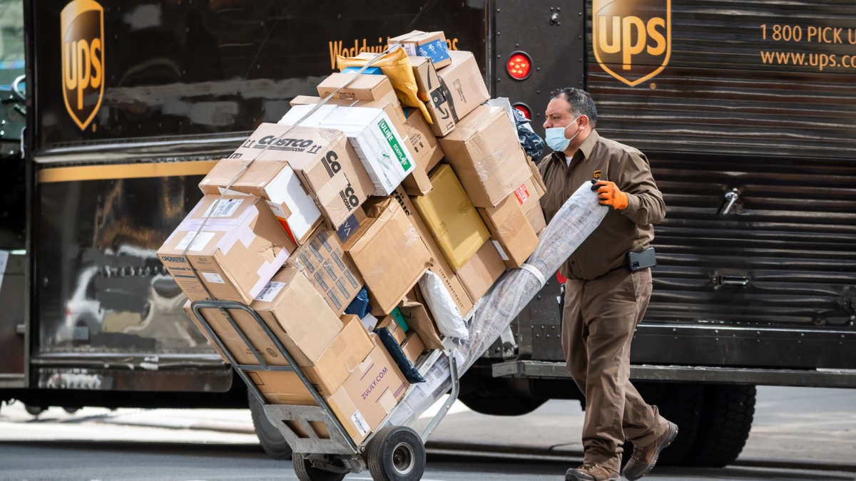 A UPS worker delivers packages on the Upper West Side on March 12, 2021, in New York City. NOAM GALAI / GETTY IMAGES