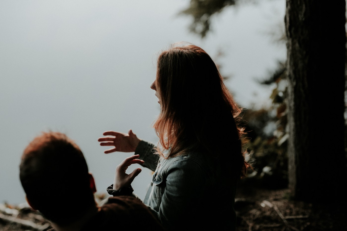 Woman talking in the woods