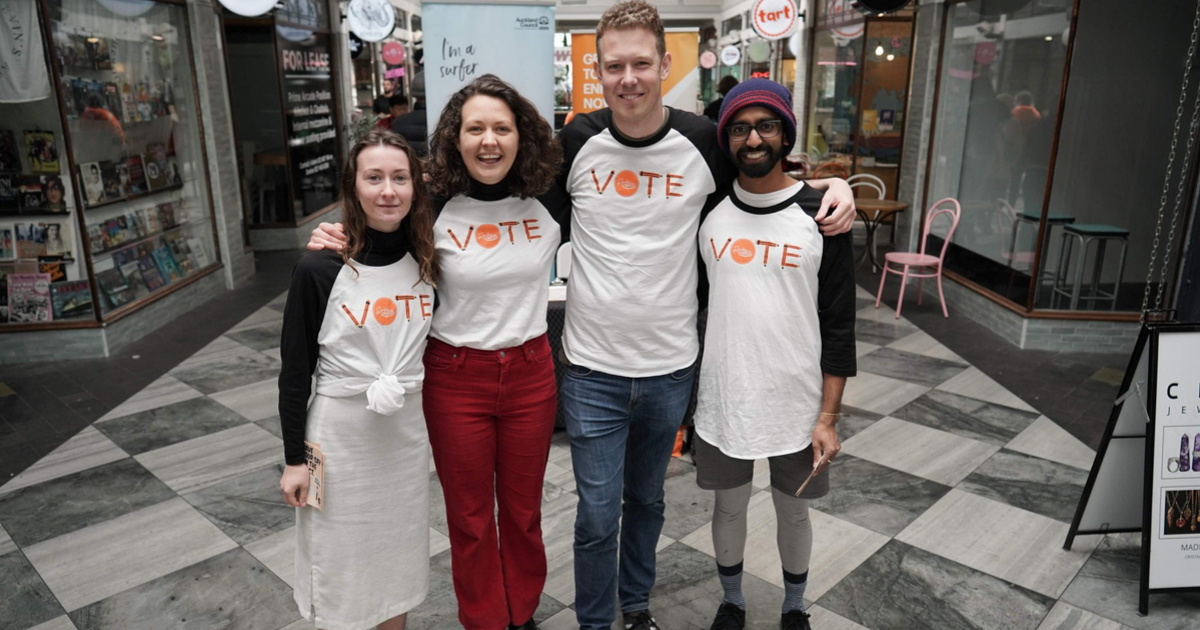 Four RockEnrol volunteers wear Vote t-shirts in Auckland's St Kevin's Arcade