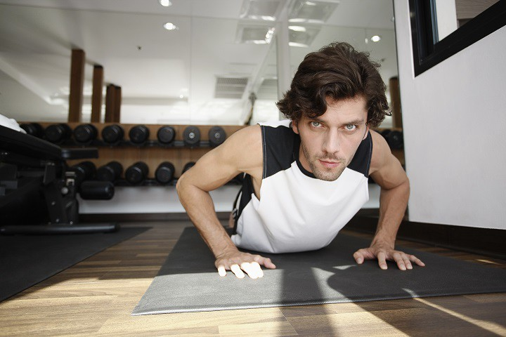 guy-lying-in-floor-and-doing-exercise-at-home