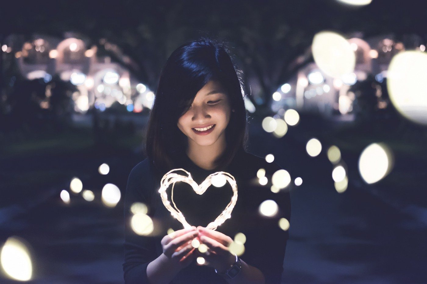 Girl holding a love symbol
