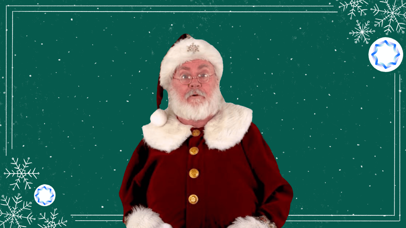 A Santa Claus in front of a green screen holiday background