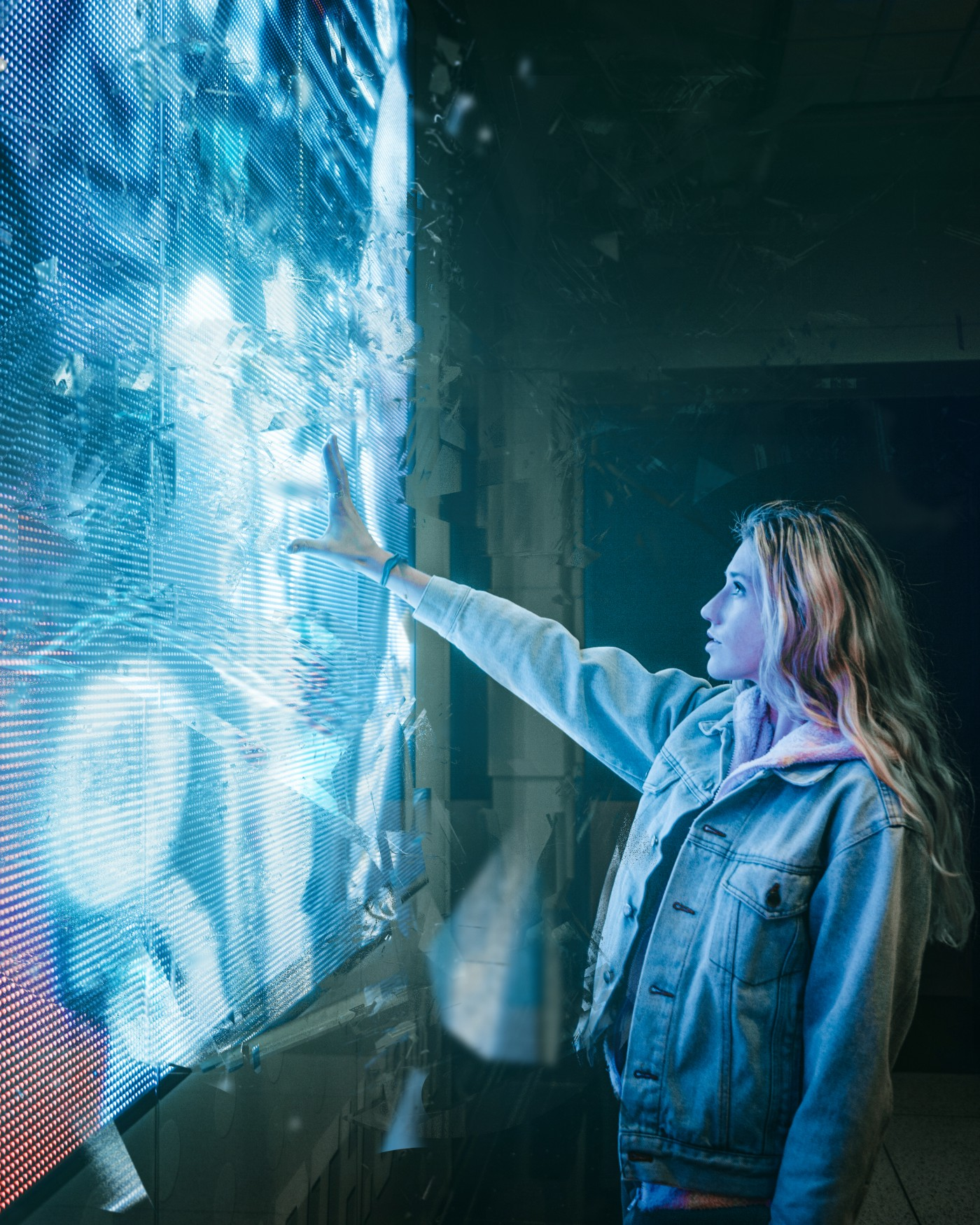 Futuristic image of a woman touching a touch-screen or hologram computer, wall sized, big, brightly lit, digital. She's wearing a blue jean jacket, it's a powerful contrast. Future tech, artificial intelligence, science fiction, science fact, futurism, future.