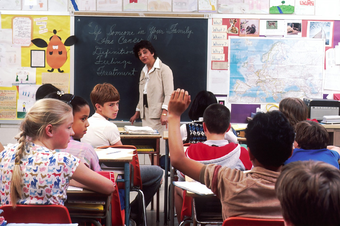 Just because you quit the job you like, it doesn't mean you failed. A teacher in front of her students teaching a lesson.